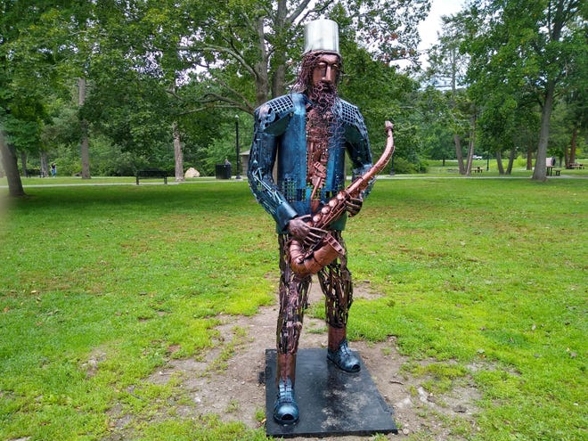 """The sculpture """"Musician,"""" by Jose Cirillo Guncay of Worcester, is on display at Art in the Park at Elm Park."""