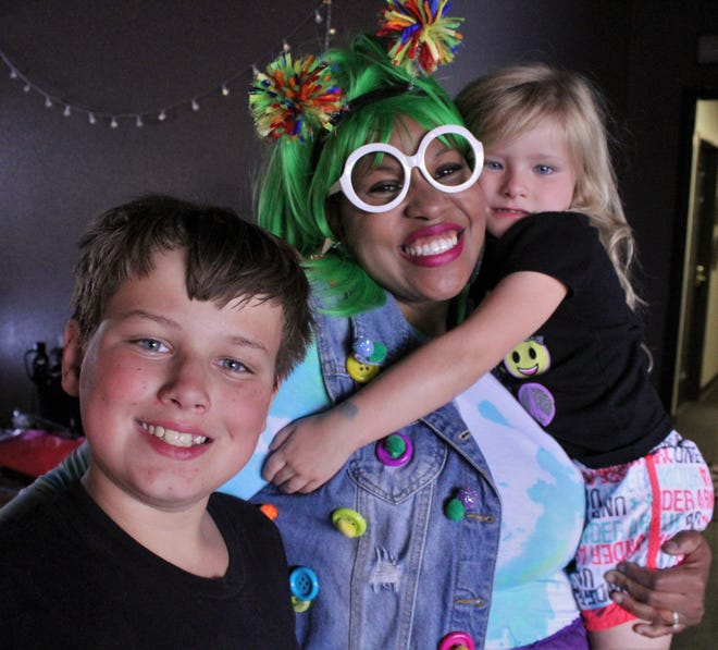 Sparkle, who is Jessica Kirts on other days, with her friends Bradyn, 11, and Addie, 5, at the Softs Hearts Inc. Back to School Bash on Sunday. Aug 15 2012
