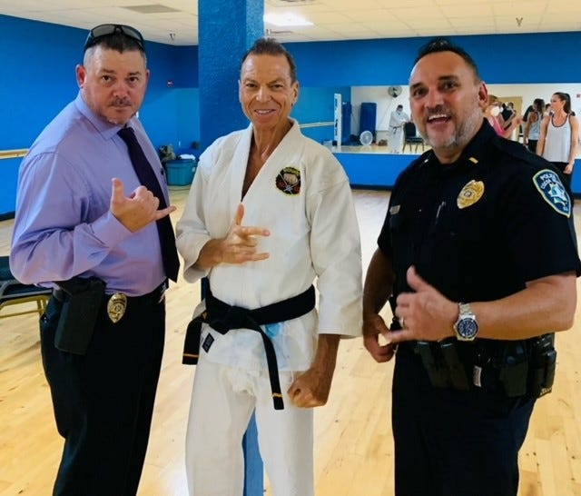 Cocoa Beach Karate owner Des Chaskelson with Lt. Manny Hernandez and Sgt. Tom Copper of Cocoa Beach PD.