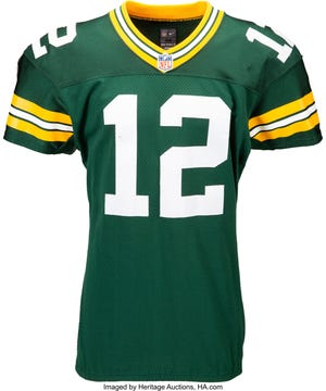 A game-used Aaron Rodgers jersey from 2013 is up for auction this weekend, and it already has set records.
