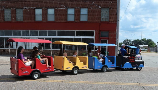 The Fun Zone Express takes children and a few parents on a train ride through Downtown Jackson during the Bicentennial Kickoff Celebration at The AMP on Saturday, Aug. 14, 2021.