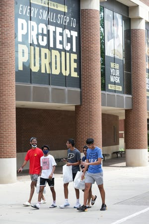 Students walk past Purdue University's Class of 1950 Lecture Hall, Monday, Aug. 16, 2021 in West Lafayette.