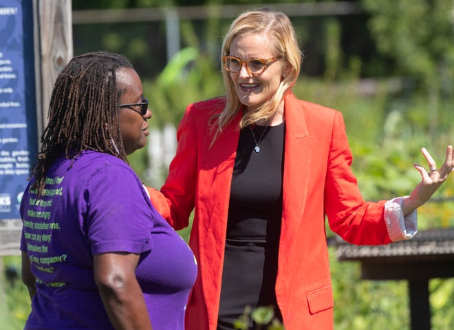 Sarah Godlewski, right, talks with Venice Williams before a campaign appearance Monday, August 16, 2021 at Alice's Garden, 2136 N. 21st St. in Milwaukee,Wis. Godlewski is seeking the Democratic nomination for U.S Senate.