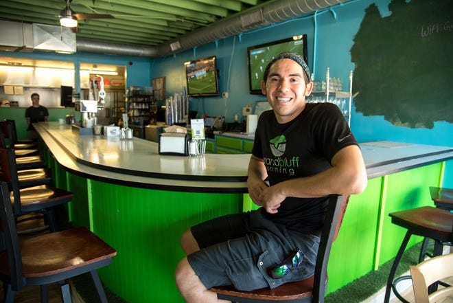 Donald Greengrass inside his La Crosse business Greengrass Cafe. Greengrass opened the business with money he received from the Ho-Chunk Nation's Child Trust Fund Program. Ho-Chunk members receive a lump sum when they turn 18 and graduate from high school, funded by revenue from the tribe's gaming facilities.