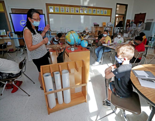 Mary Lawler teaches a 4th-6th grade class during the first day of school at MacDowell Montessori School.