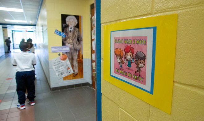 Signs, posted around Martin Luther King Jr. Elementary School, encourage students to wear a mask at all times.