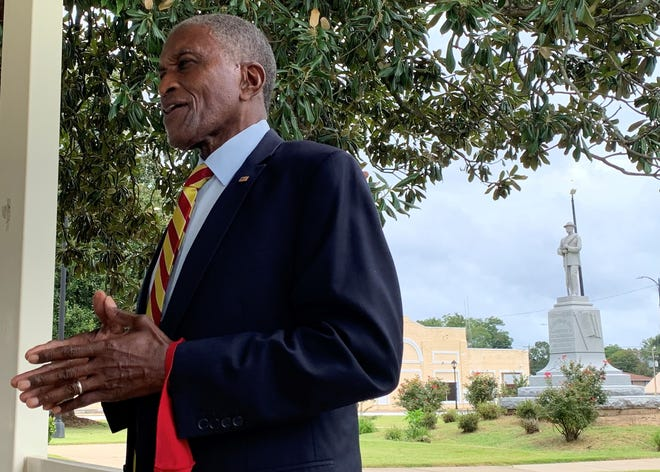 Tuskegee City Councilman Johnny Ford discusses his plans to attempt to force the removal of a Confederate statue in downtown Tuskegee on Aug. 16, 2021. The statue can be seen behind Ford.