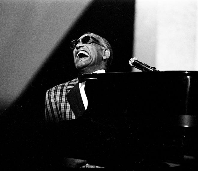 Legendary Ray Charles sways back and forth on his piano bench as he performs with a host of artists during the 18th annual CMA Awards show Oct. 8, 1984.