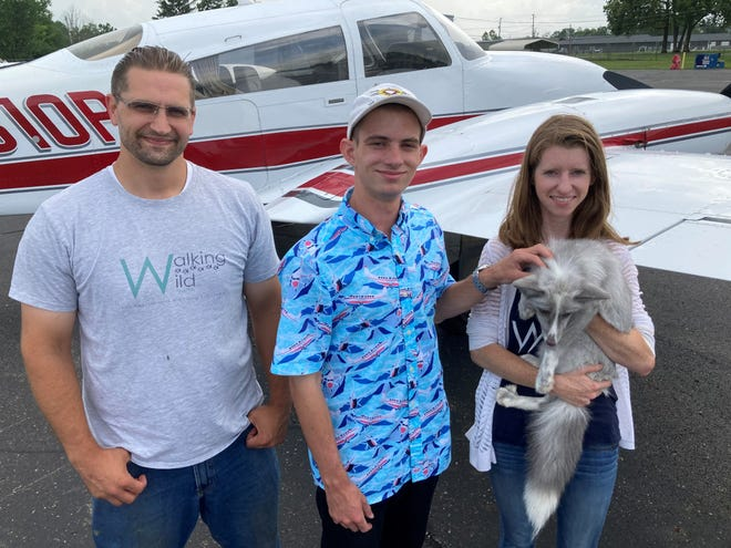 David Schulz, volunteer pilot Jacob Rypien, Molly Schulz and the still to be named young female fox Rypien flew from Florida to Licking County on Aug. 13.