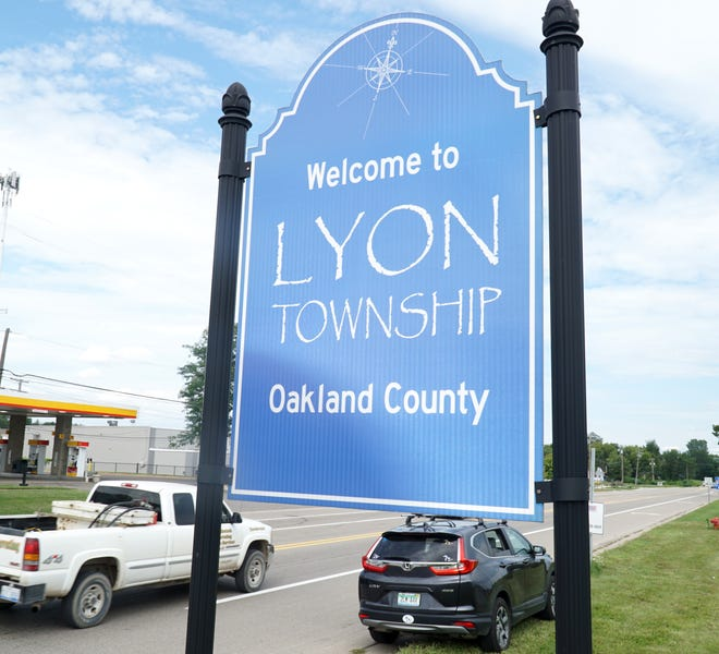 """A """"Welcome to Lyon Township"""" sign stands at Eight Mile Road and Pontiac Trail."""