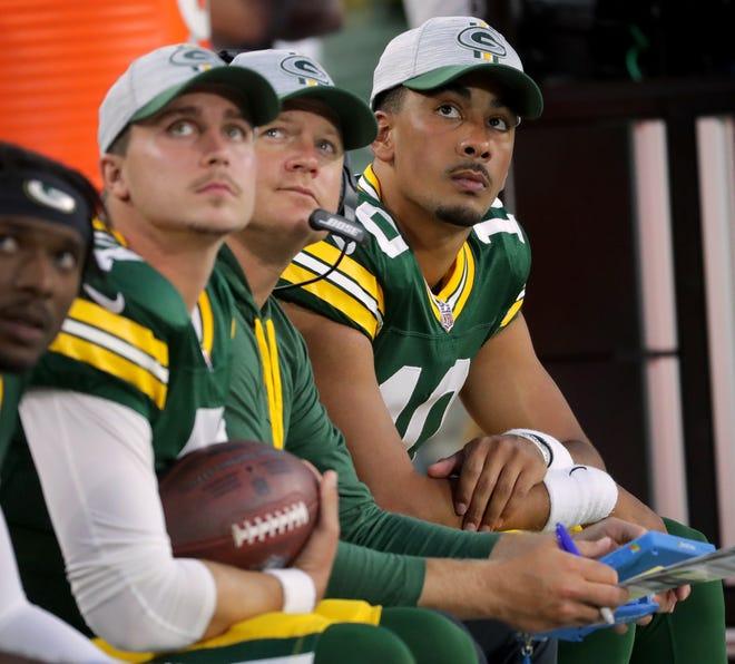 Packers quarterback Jordan Love (10) sits with quarterback coach Luke Getsy and quarterback Kurt Benkert (left) during their preseason game Saturday.  MARK HOFFMAN/MILWAUKEE JOURNAL SENTINEL