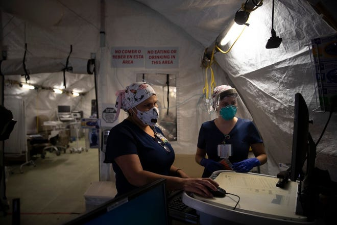 Nurses Karla Salazar, right, and Marisol Perez work in a tent set up to help treat COVID-19 patients at El Centro Regional Medical Center in El Centro on July 21, 2020. Hit hard by COVID-19, Imperial County now has a high vaccination rate. Photo by Jae C. Hong, AP Photo