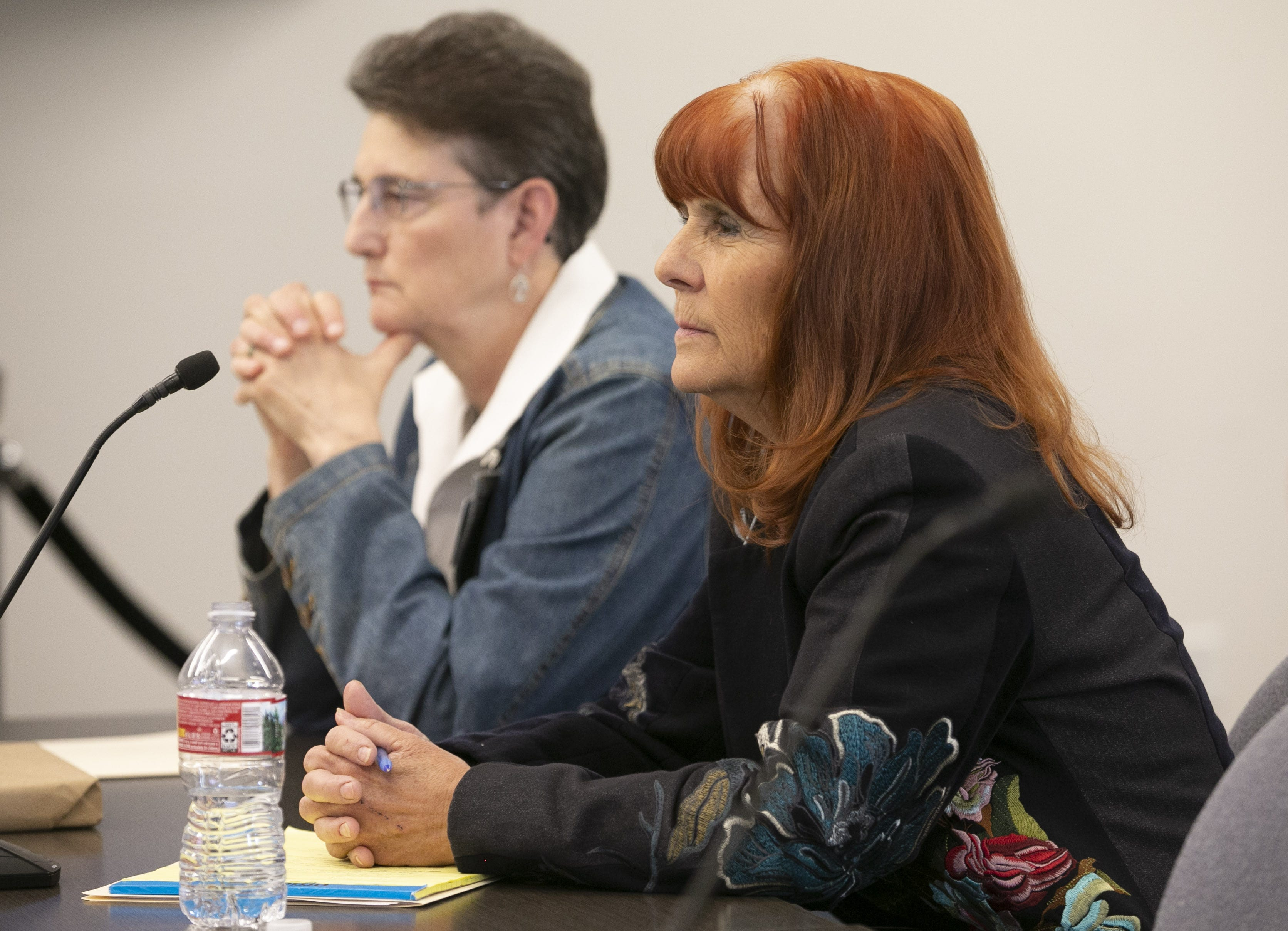 Victoria Bowmann (right) and Mlee Clark, chair and vice chair  of the Arizona State Board of Massage Therapy, listen during a public board meeting on Jan. 31, 2020, in Phoenix.