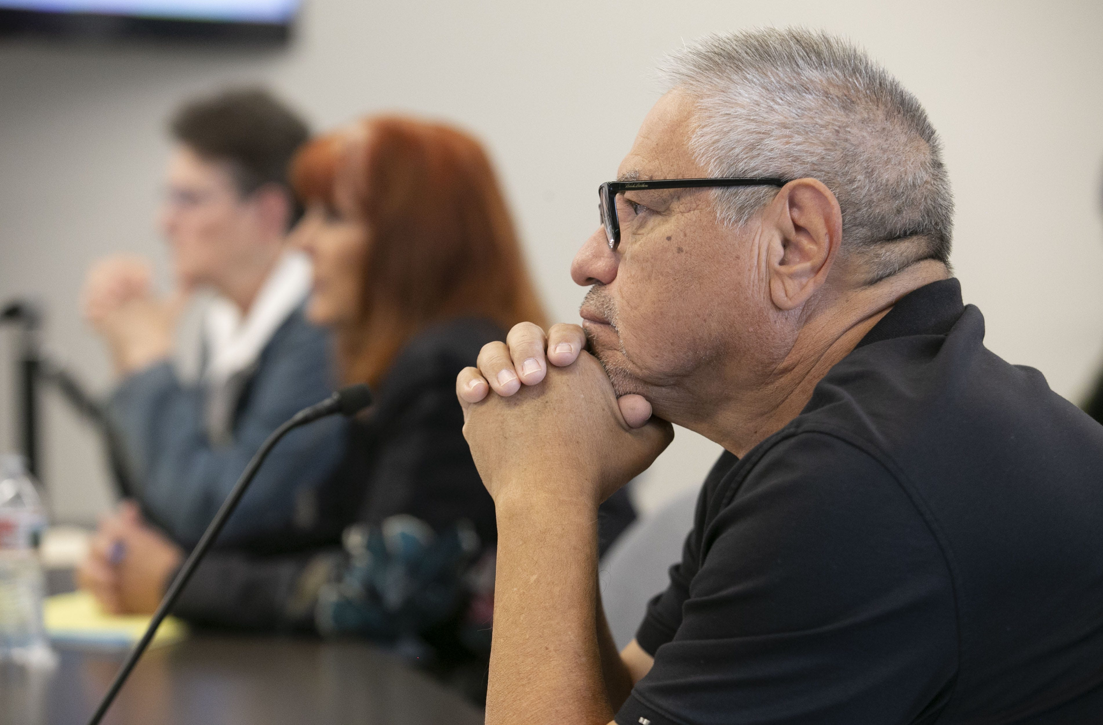 John Ortega, a member of the Arizona State Board of Massage Therapy, listens during a public board meeting on Jan. 31, 2020.