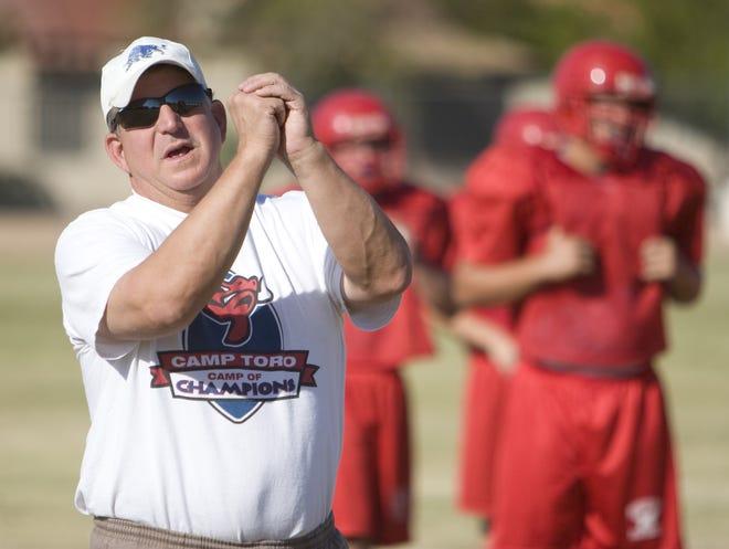 155079 mr-joseph1024  9/13/2008  Mountain View High School head football coach Tom Joseph signals to his players. Russell Gates/The Arizona Republic