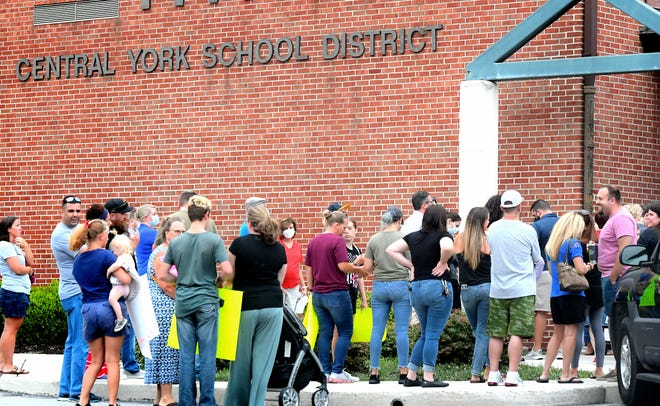 People gather before entering the Central York School District offices prior to a school board meeting there Monday, Aug. 16, 2021. A group of about 70 people rallied outside the office regarding pandemic safety procedures in the district. Bill Kalina photo