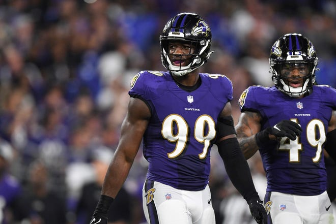 Baltimore Ravens linebacker Odafe Oweh (99) looks on between play during the third quarter of an NFL preseason football game New Orleans Saints, Saturday, Aug. 14, 2021, in Baltimore. (AP Photo/Terrance Williams)
