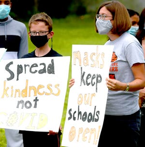 District resident Beth Reilly and her son Eamon, 12, a district sixth-grader, rally outside the Central York School District offices prior to a school board meeting there Monday, Aug. 16, 2021. They were advocating for stronger pandemic safety protocols in the district. Bill Kalina photo