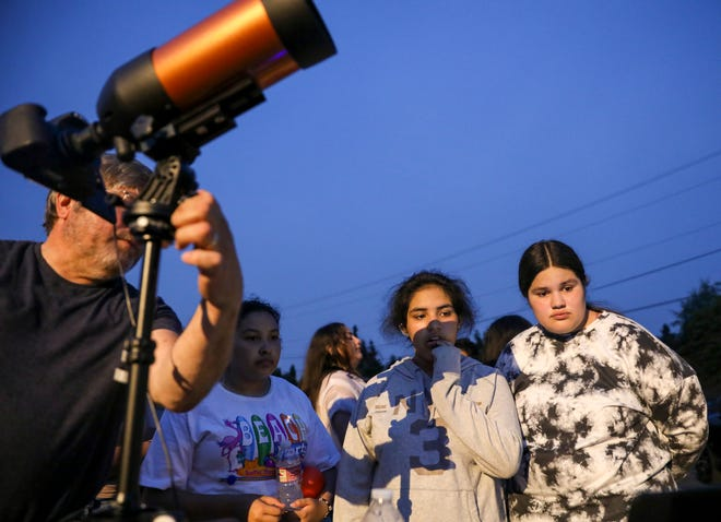 Students get a lesson in astronomy and a look at the stars during an event hosted by Salem Dream Center and Salem's Night Sky 45 Astronomy Club on Saturday, Aug. 14, 2021, at the Salem Dream Center.