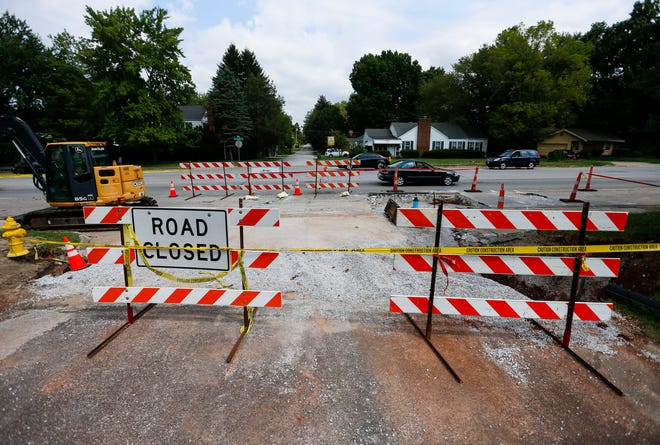 Cars pass by construction on East Sunshine Street on Monday, Aug 16, 2021. City Utilities is replacing the water main in the area and the project is scheduled to be completed by October 1st.