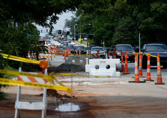 Cars pass by construction on East Sunshine Street on Aug 16, 2021. Missouri's roads, bridges, water systems and other infrastructure priorities are expected to receive over $9 billion as part of the federal infrastructure package awaiting a final vote in the U.S. House of Representatives.
