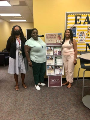 The Florida Center for Reading Researchat Florida State University has launched an online resource section specifically for families. Here, Florida Center for Reading Research Director Nicole Patton Terry, Title I Advisory Council Chair Talethia Edwards, and Principal DelshaunaJackson stand next to a Literacy Kiosk at Bond Elementary School.