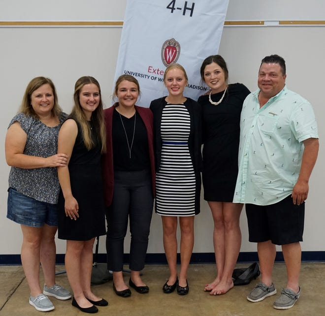 The Manitowoc County Senior Dairy Judging Team advanced to the National 4-H Dairy Cattle Judging contest next month at World Dairy Expo by finishing first place at the State 4-H Senior Dairy Judging Contest on August 9, 2021. Coached by Angie Ulness, far left, and Paul Siemers, far right, are Clarissa Ulness, second from left, Emma Vos, Jenna Gries, and Lauren Siemers.