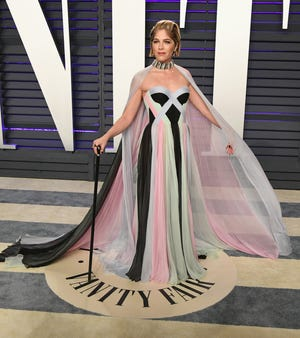Actress Selma Blair poses with a cane on the carpet at Vanity Fair's annual Oscars soirée on Feb. 24, 2019 in Beverly Hills.