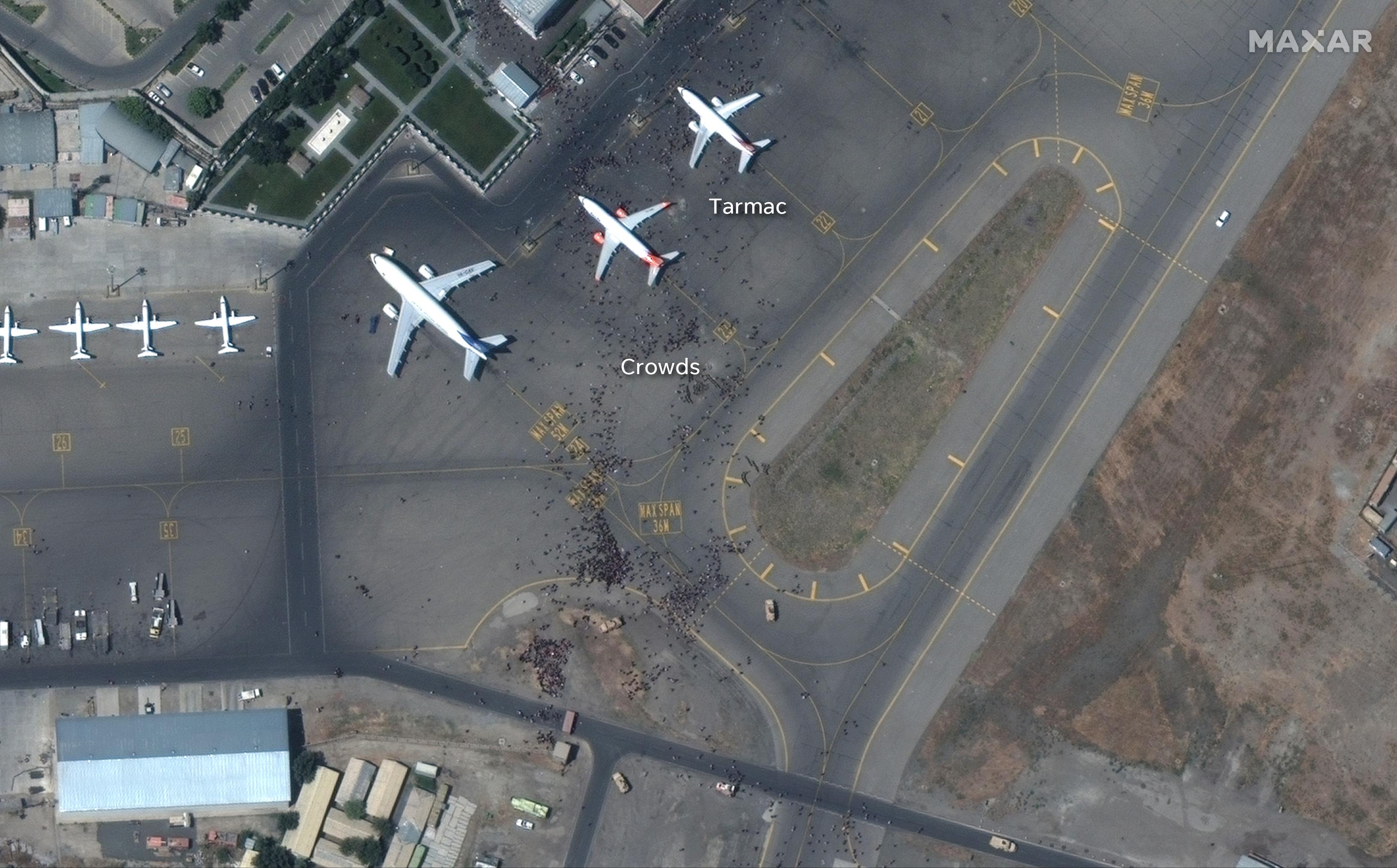 Crowds on the tarmac of Hamid Karzai International Airport Aug. 16, 2021.
