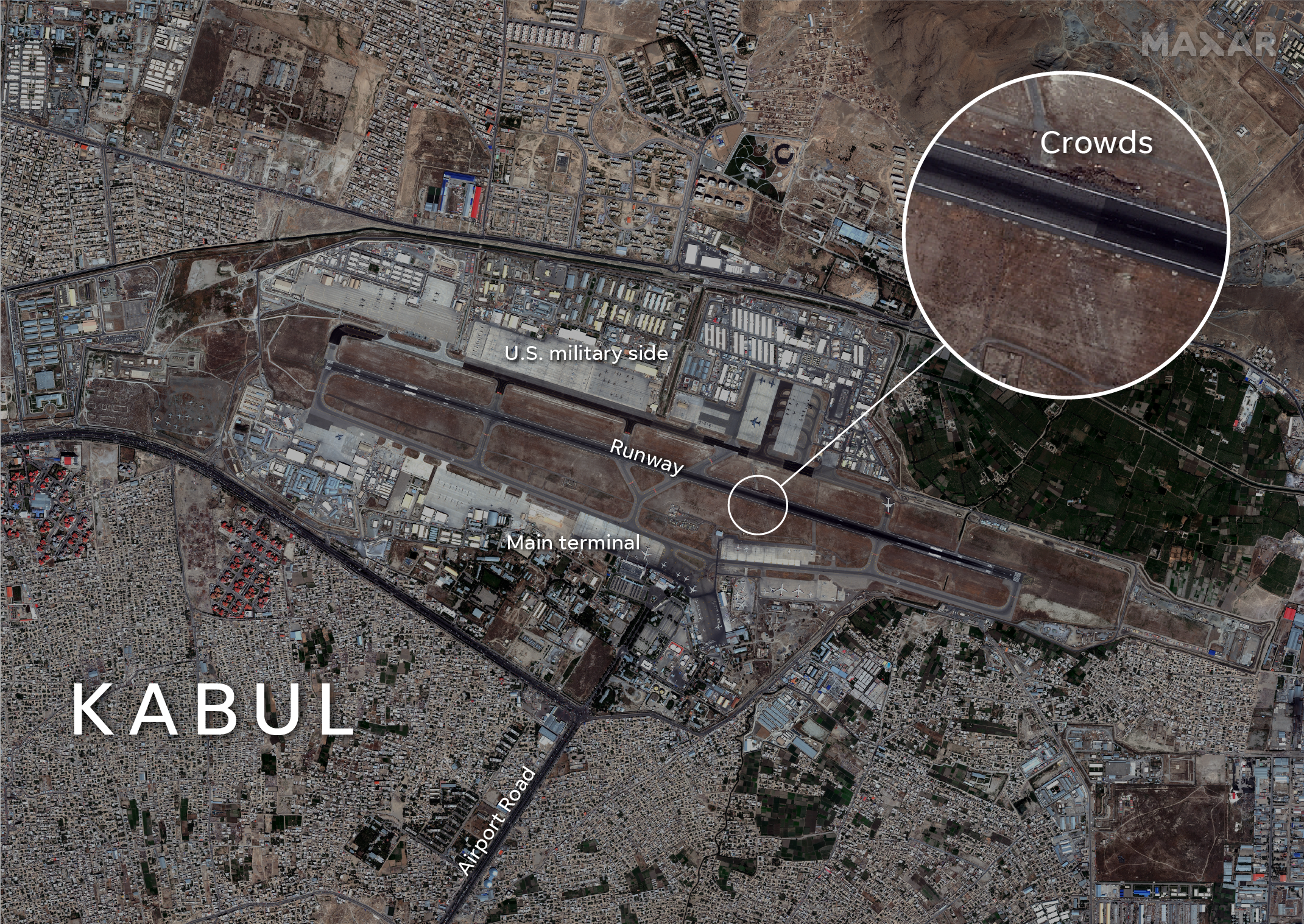 A satellite image of Hamid Karzai International Airport on Monday shows crowds of Afghans gathered on the runway.