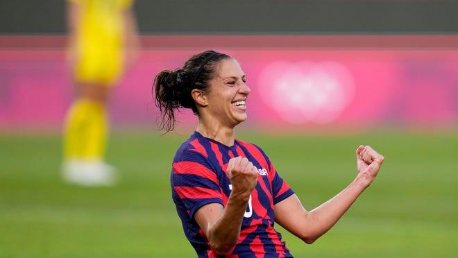 United States' Carli Lloyd celebrates scoring her side's 4th goal against Australia in the women's bronze medal soccer match at the 2020 Summer Olympics, Thursday, Aug. 5, 2021.