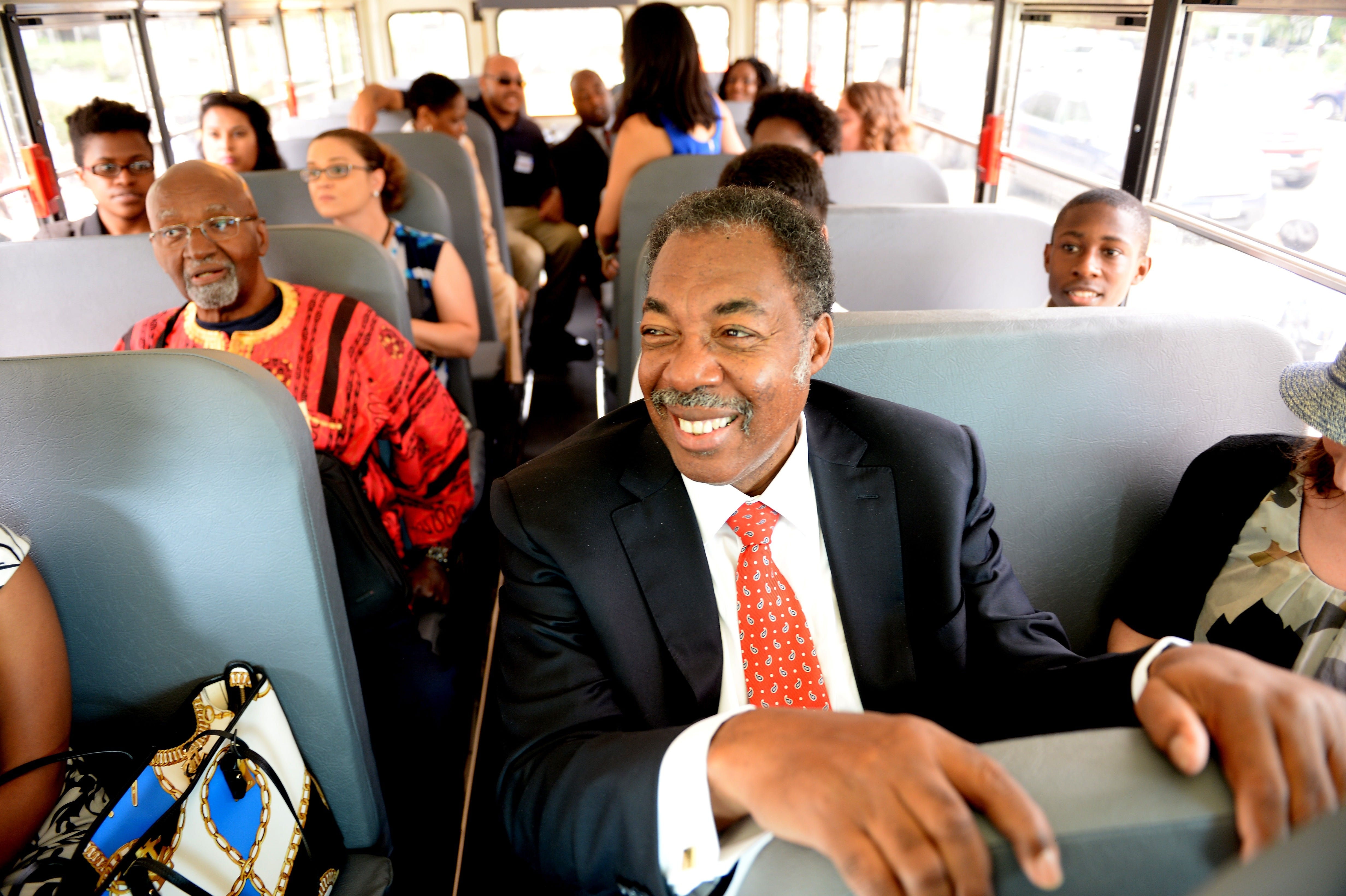 Freedom Rider Hank Thomas, front, sits on a bus for a ride to the Virginia State Capitol in Richmond after a ceremony marking the 50th anniversary of the Civil Rights Act at the Department of Education, July 2, 2014.