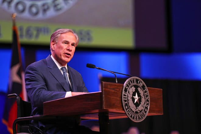 Texas Gov. Greg Abbott is asking medical workers from out of state to come to Texas to help fight a surge in coronavirus cases. [AARON E. MARTINEZ/AUSTIN AMERICAN-STATESMAN/TNS]