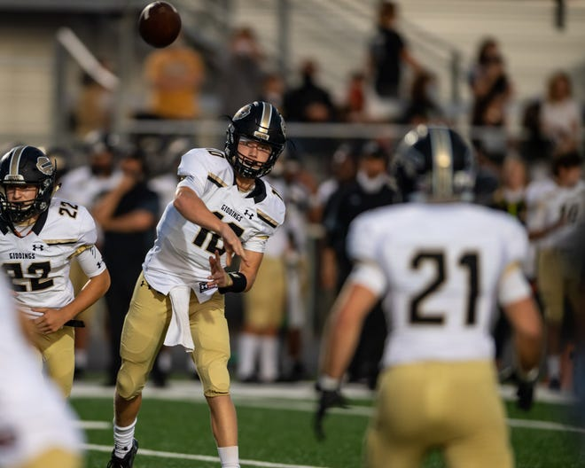 Giddings' Holden Jatzlau passes to Gage Jaehne during a game versus Taylor in the 2020 season. The returning starter threw for 1,326 yards and added 557 more on the ground a year ago.