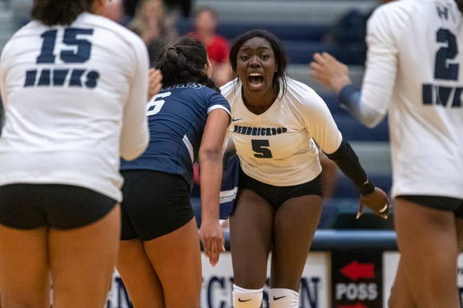 Hendrickson outside hitter Katherine Neille celebrates scoring against Georgetown on Aug. 10. Over the weekend, the Hawks won the Bastrop ISD Classic volleyball tournament with a perfect 9-0 record.