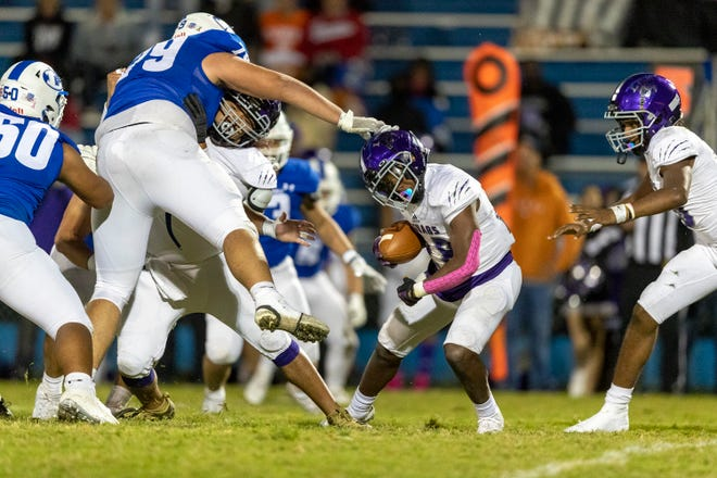 LBJ running back Sedrick Alexander, right, looks to escape a tackle by Lampasas defensive lineman John Long during a game last season. Alexander, who ran for more than 1,000 yards a year ago, leads a loaded backfield for the defending Region IV champion Jags.