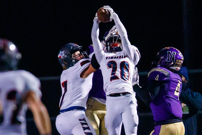 Wimberley defensive back Canyun Staton, intercepting a pass last season against district rival Navarro, is among the returning players who helped the Texans win 12 games in 2020.