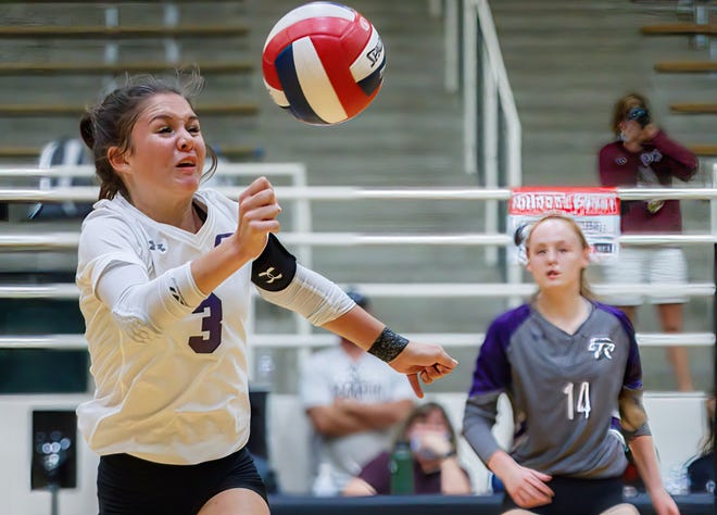 Cedar Ridge libero Alyssa Clark tries to save the ball against the Austin High Maroons during the second set at the nondistrict volleyball game on Monday at the Toney Burger Activity Center in Austin. Cedar Ridge rallied from a two-set deficit to win in five sets.