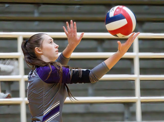 Cedar Ridge setter Faith Cox serves the ball during a match against Austin High in August. The senior collected 48 assists in a victory over Hendrickson after notching 31 in a win over Round Rock Christian last week.