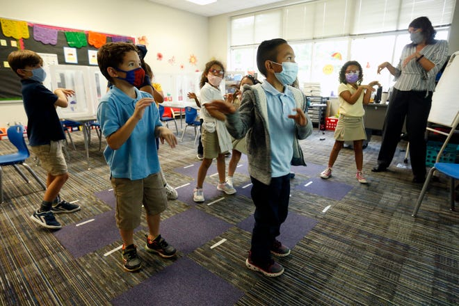First grade teacher Jessie Garcia works with her dual language immersion class at Oglethorpe Avenue Elementary in Athens on Aug. 17.