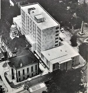 A newspaper photo  from the 1950s shows the Municipal Building constructed in what had been the lawn of the old Richmond County Courthouse.