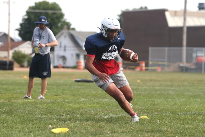 Rochester's Amaree Curry works on his foot work during Rams training camp Monday afternoon at Rochester High School.