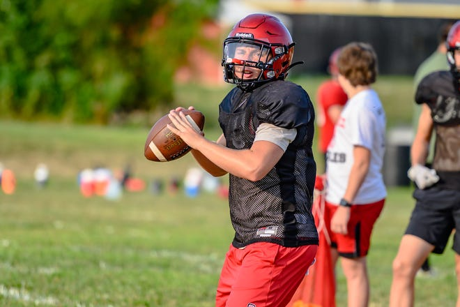 Southern Boone quarterback Hayden Steelman looks for an open receiver during passing drills in preseason practice.