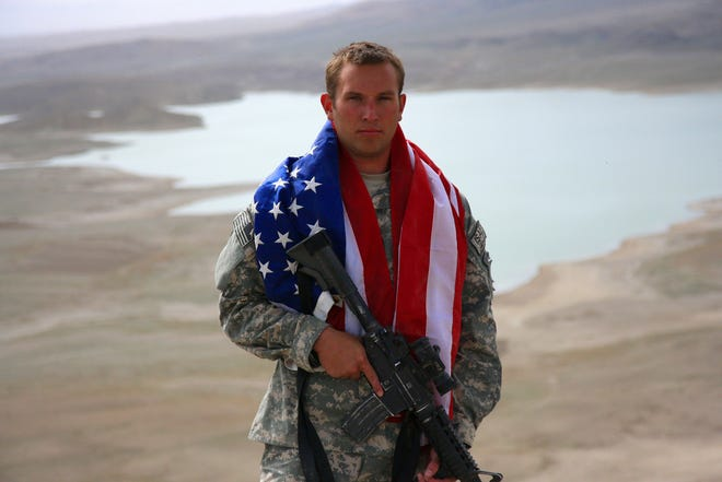 Eric Sowers, the mentor coordinator for the Delaware Mission/Veterans Treatment Court in Delaware County, stands atop a mountain while deployed to Afghanistan in 2007 as part of Operation Enduring Freedom. The news out of Afghanistan, Sowers said, is difficult for veterans like himself and those he serves in the court to process.