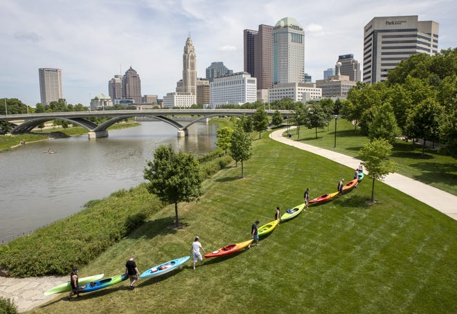After kayaking on the Scioto River, a group of friends from Westerville pull their boats out of the water at the Scioto Mile in downtown Columbus on July 3, 2020.
