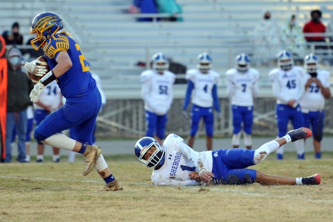 Southwestern Randolph's Eli Gravely takes off after catching a pass against Asheboro in a spring 2021 game. [Mike Duprez/Courier-Tribune]