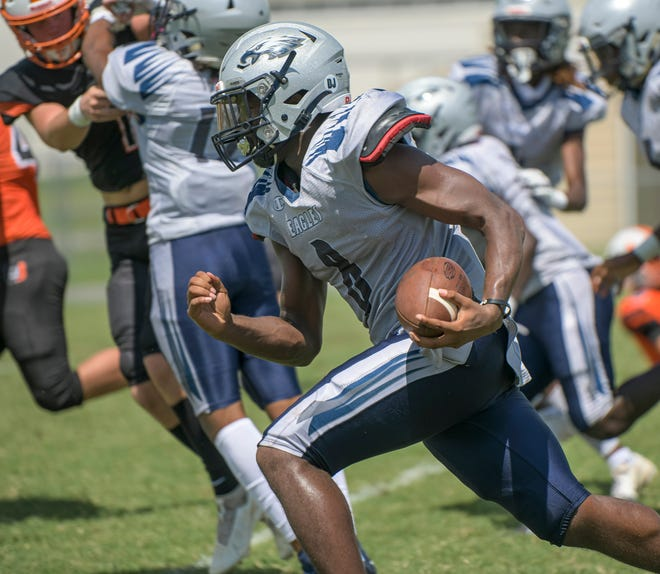 South Lake's Quinton Nelson (8) heads for the end zone during Saturday's Officials Jamboree at Leesburg High School in Leesburg. [PAUL RYAN / CORRESPONDENT]