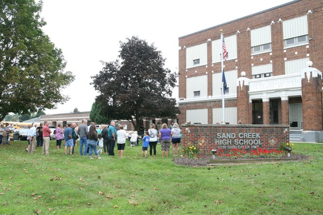 Sand Creek school alumni, staff, retirees and community members gather Monday for a program that marked the 100th anniversary of the groundbreaking for what is now Sand Creek Jr./Sr. High School.