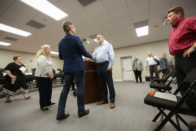 Darryl Martin, center, is sworn into office to serve on the Maury County Commission representing District 4 by Maury County Mayor Andy Ogles, right, inside the Tom Primm Commission Meeting Room in Columbia, Tenn., on Monday Aug. 16, 2021.