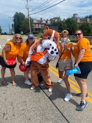 The Pope Memorial Dog Mascot helped volunteers raise money at the shelter's Road Toll fundraiser on Aug. 14.